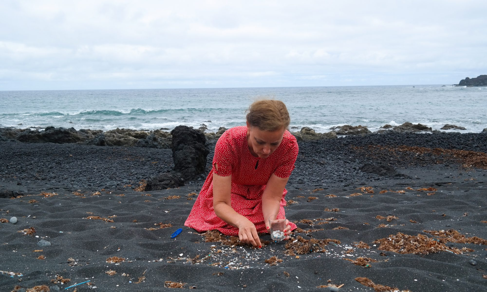 Artist Swaantje Güntzel clears a squaremeter of beach of microplastics in Lanzarote (Spain). During her intervention, she counted 1370 pieces. Image: Jan Philip Scheibe
