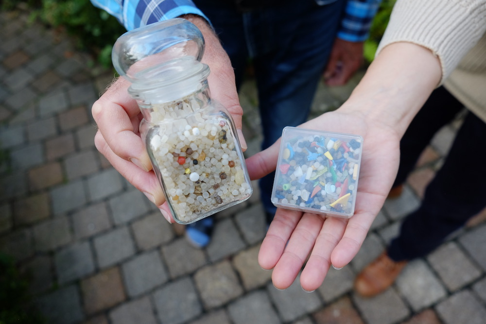 Hans has kept the plastic beads he found in 1974, in a glass jar he doesn't open. On the right hand side, some finds from more recent years, when the plastics on the beaches became more diverse and colorful.