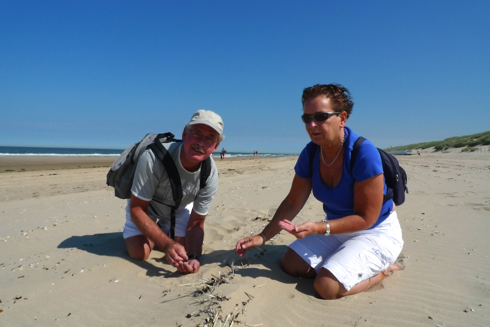Hans and Marja van Weenen collecting plastics on the beach in the Netherlands, in 2014. Photo by: Anja Krieger